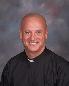 Father Zach Etienne